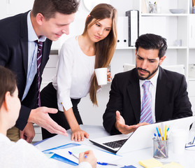 Business partners discussing in office