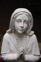 Woman praying garden statue