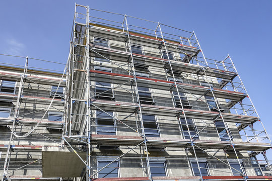 Front of a high-rise covered in scaffolding