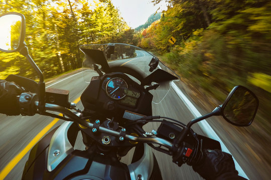 Driving Motorcycle on forest montait twisties road