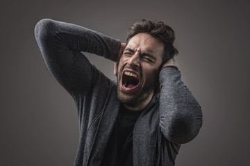 Enraged troubled man screaming in anger, crazy and mental
