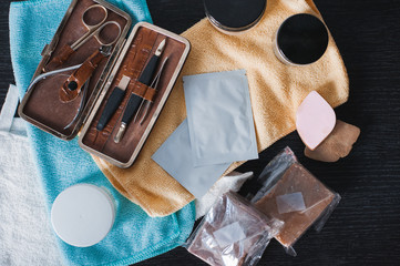 Woman care accessories for everyday. Colorful towels, organic mask, nail set, soap and hair styling gel