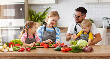 appy family with child  preparing vegetable salad