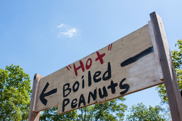 Handpainted Festival Sign Points Toward Sale Of Hot Boiled Peanuts