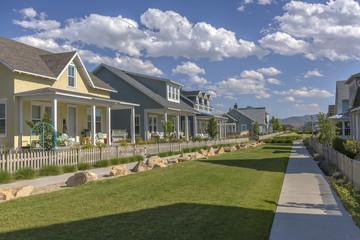 Community lawn between homes and sidewalks