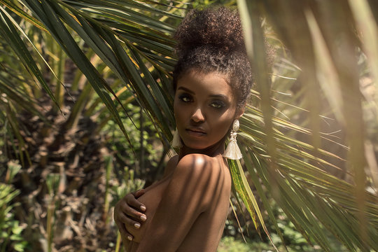 Tropical shoot of african american beauty.