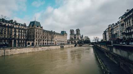 Cathedral de Notre Dame on the bank of the flooded River Seine, Paris, France