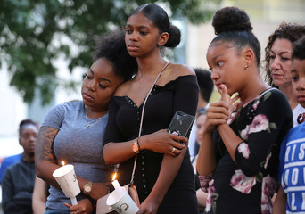 Friends and family of rapper Smoke Dawg attend a vigil following his shooting death in Toronto