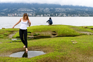 People exploring the intertidal zone of Vancouver, British Columbia