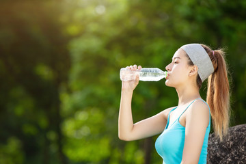 Girl drinking water exercise.