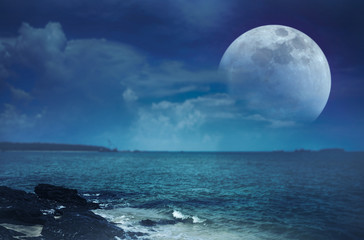 Landscape of sky with super moon on seascape. Serenity nature.