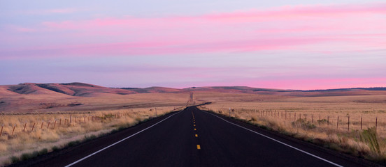 Door stickers Light pink Flat Two Lane Blacktop Highway Heads into the Pink Sunset