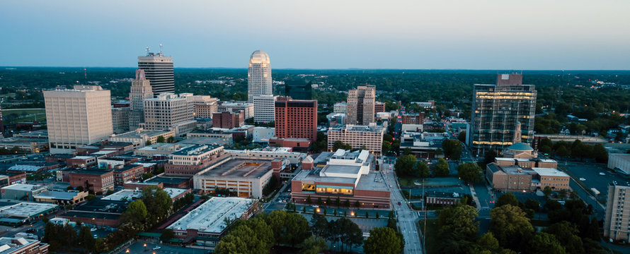 Aerial View as Night Falls on the Downtown City Skyline at Winston-Salem