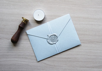 Flat lay stylish mockup photo with handmade envelope with seal wax stamp on the light wooden background. Feminine photo for blog and website.