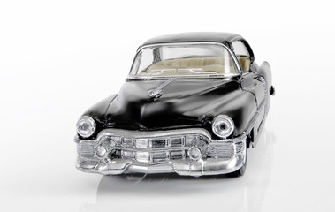 The front view on model of the classical American car of black color.
