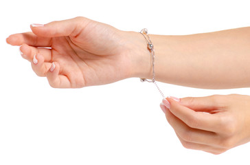 Female hand in silver bracelet pearls on white background isolation