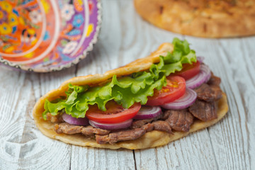 background,barbecue,beef,board,bottle,bread,cabbage,chicken,closeup,dinner,dish,donner,döner,fast,food,greek,green,grilled,gyro,hamburger,health,healthy food,kebab,kebap,lettuce,lunch,meal,meat,onion,