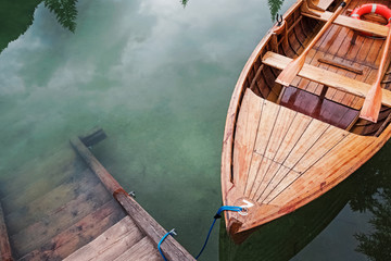 Wooden boat on the beautiful mountain lake,