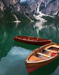 Wooden boats on the beautiful lake Braies,