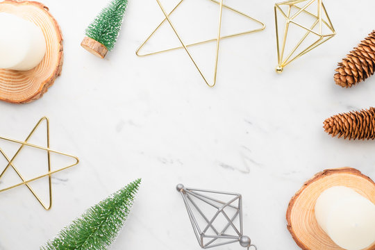 Top view of luxury marble christmas , star, candle ,wood plate, tree Christmas, with pine cone on table top,Flat lay holiday celebration still life,mock up for adding text,copy space.nordic style