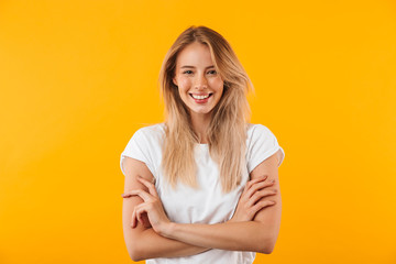 Portrait of a smiling blonde young woman Wall mural