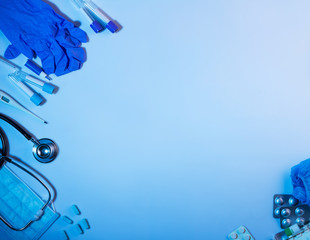 Diagnostic and first aid items, laid out on blue background