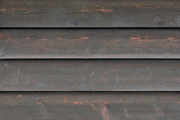 Fototapete - Background texture from faded black wooden boards, close up