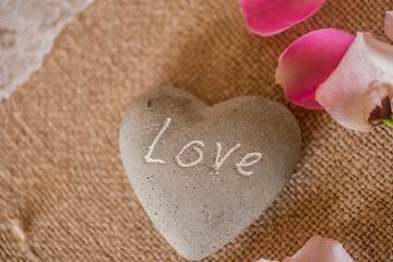 stone in a shape of heart with LOVE engraved