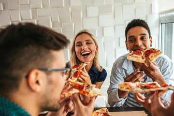 Grabbing a slice of pizza with friends