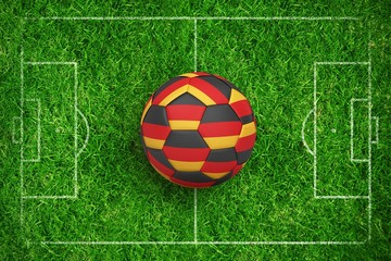 Composite image of football in german colours