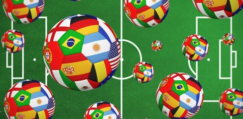 Composite image of footballs in international flags