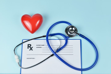 Stethoscope, red heart and prescription on blue background, Heart Check.Concept healthcare.