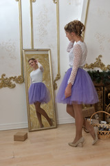girl teenager in dress at mirror