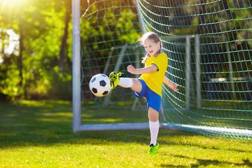 Brazil football fan kids. Children play soccer.