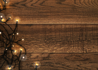 Christmas Light or Garland Lights on Wood Background