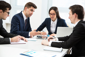 Businessman explains to colleagues a new project