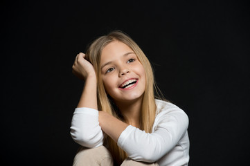Dreamy mood. Girl long hair cute smiling dreamy face relaxing, black background. I wish all my dreams come true. Child happy carefree dreaming about future. Dreams come true