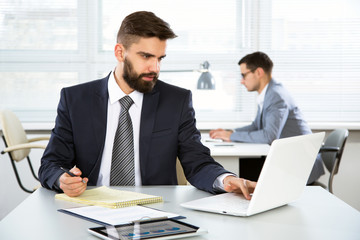Young businessman working in an office