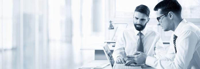 Businessmen working in an office