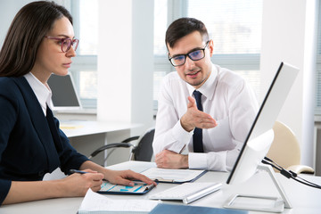 Businessman explains to colleague a new project