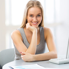 Young woman using computer at home