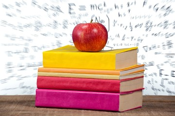 Apple with books on table