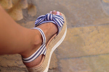 beautiful open sandals on a slender tanned leg girl