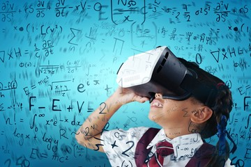 Composite image of close-up of schoolgirl using virtual reality