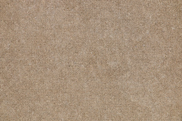 Brown concrete floor texture with small dash pattern. Close-up of speckled grunge background