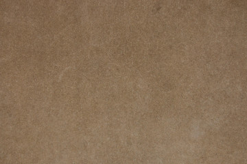 Brown concrete wall with fine grain texture. Photo of vintage plain background. Horizontal orientation