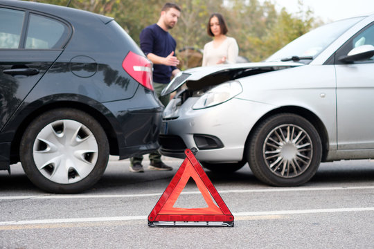 People checking car damages after car accident