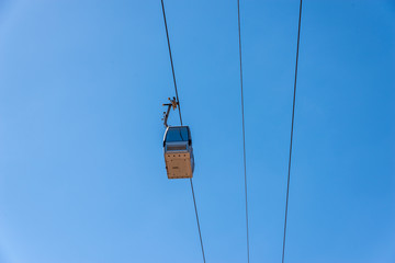 cableway against the sky, transport at height and tourist attraction