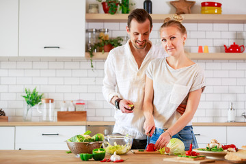 Image of beautiful couple in love preparing breakfast