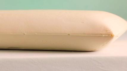 Wall Mural - Mano che tocca un materasso in memory foam tecnologico. Super Slow motion.